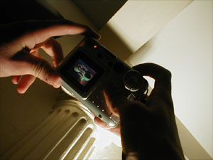 hands holding camera